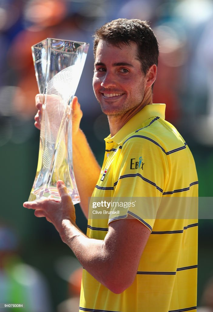 John Isner of the United States holds the Butch Bucholz trophy after his three set victory against Alexander Zverev of Germany in the mens final during the Miami Open Presented by Itau at Crandon Park Tennis Center on April 1, 2018 in Key Biscayne, Florida.