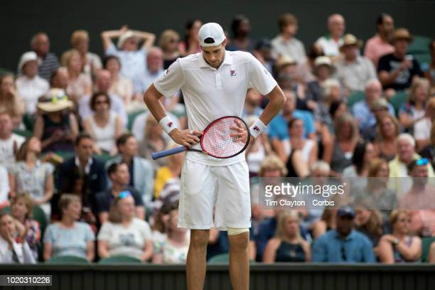 John Isner of the United States in action against Kevin Anderson of South Africa in the Men's Singles Semifinal on Center Court during the Wimbledon...