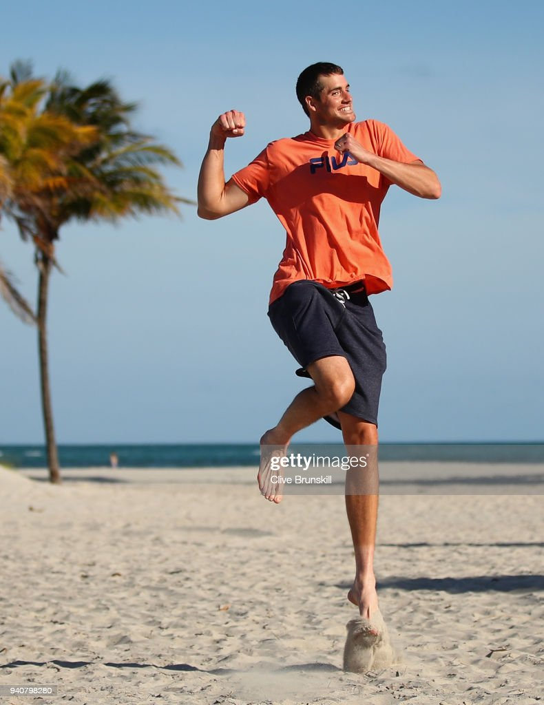 John Isner of the United States jumps for joy on Crandon Park Beach after his three set victory against Alexander Zverev of Germany in the mens final during the Miami Open Presented by Itau at Crandon Park Tennis Center on April 1, 2018 in Key Biscayne, Florida.