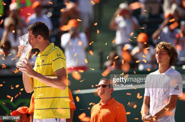 John Isner of the United States kisses the Butch Bucholz trophy after his three set victory against Alexander Zverev of Germany in the mens final...