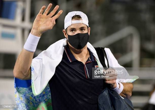 John Isner of the United States leaves the court after losing to Sebastian Korda in three sets during the Quarterfinals of the Delray Beach Open by...