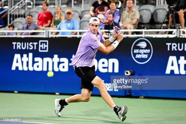John Isner of the United States looks to return a shot from Taylor Fritz of the United States during a semifinal singles match at the Truist Atlanta...