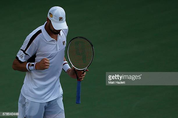 John Isner of the United States of America celebrates after defeating Marco Baghdatis of Cyprus 76 62 during day 4 of the Citi Open at Rock Creek...