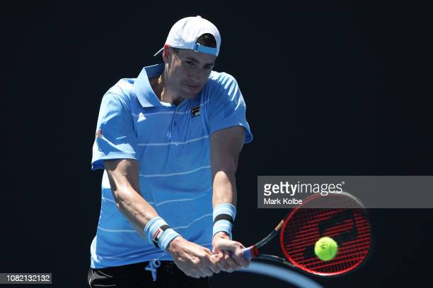 John Isner of the United States plays a backhand in his first round match against Reilly Opelka of the United States during day one of the 2019...