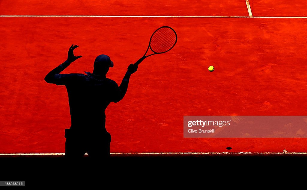 John Isner of the United States plays a forehand against Teymuraz Gabashvili of Russia in their first round match during day three of the Mutua Madrid Open tennis tournament at the Caja Magica on May 5, 2014 in Madrid, Spain.