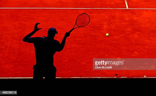 John Isner of the United States plays a forehand against Teymuraz Gabashvili of Russia in their first round match during day three of the Mutua...