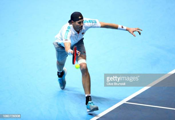 John Isner of The United States plays a forehand during his singles round robin match against Novak Djokovic of Serbia during Day Two of the Nitto...