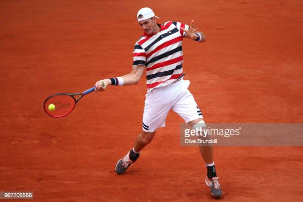 John Isner of The United States plays a forehand during the mens singles fourth round match against Juan Martin Del Potro of Argentina during day...