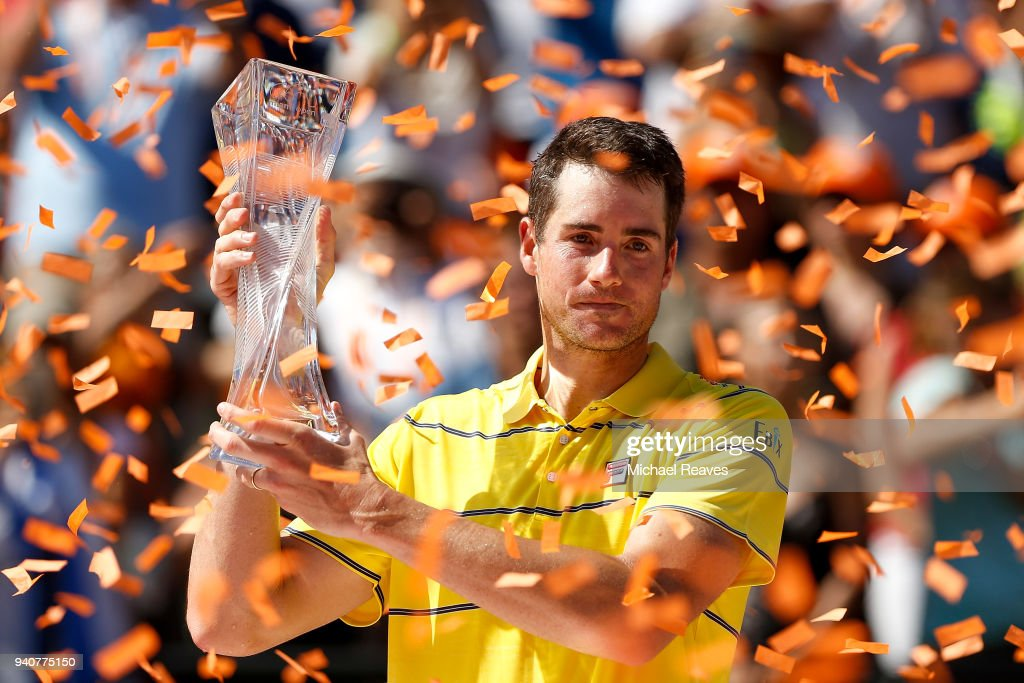 John Isner of the United States poses for a photo with the Butch Buchholz Trophy after defeating Alexander Zverev of Germany in the men's final on Day 14 of the Miami Open Presented by Itau at Crandon Park Tennis Center on April 1, 2018 in Key Biscayne, Florida.