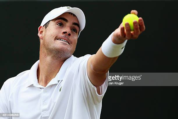John Isner of the United States prepares to serve during his Gentlemen's Singles third round match against Feliciano Lopez of Spain on day seven of...