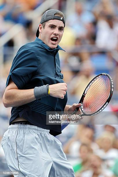 John Isner of the United States reacts after defeating Marco Chiudinelli of Switzerland during his men's singles match on day five of the 2010 U.S....