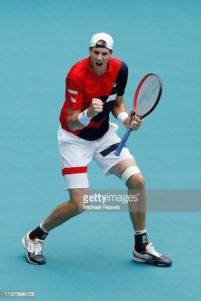 John Isner of the United States reacts during his match against Albert Ramos Vinolas of Spain during Day 7 of the Miami Open Presented by Itau at...