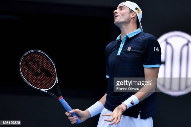 John Isner of the United States reacts during his Men's singles quarterfinal match against Rafael Nadal of Spain on day seven of the 2017 China Open...