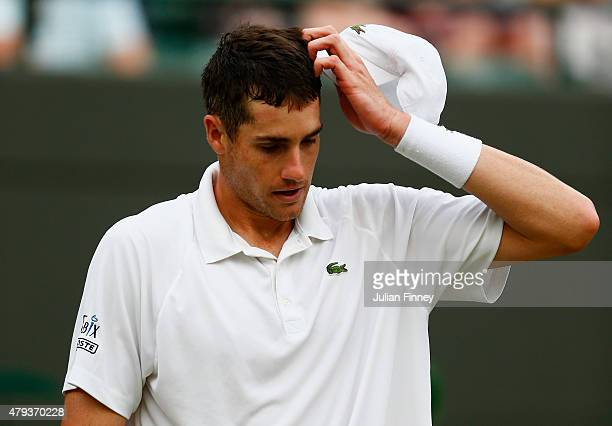 John Isner of the United States reacts in his Gentlemen's Singles Third Round match against Marin Cilic of Croatia during day five of the Wimbledon...