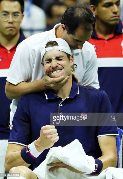 John Isner of the United States receives treatment during a break in play in his third round match against Mischa Zverev of Germany on Day Five of...