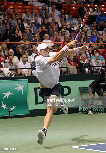 John Isner of the United States returns a serve against Serbia's Novak Djokovic during a Davis Cup quarterfinal at Taco Bell Arena in Boise Idaho on...