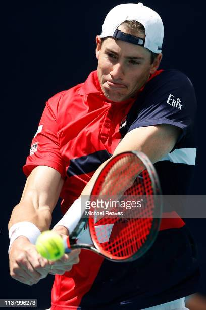 John Isner of the United States returns a shot to Albert Ramos Vinolas of Spain during Day 7 of the Miami Open Presented by Itau at Hard Rock Stadium...