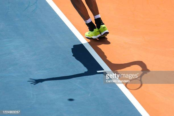 John Isner of the United States returns the ball against Christopher Eubanks of the United States during the final day of the DraftKings All-American...