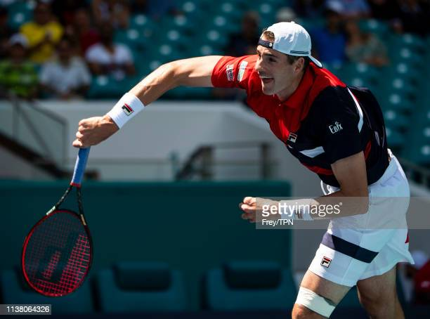 John Isner of the United States serves against Albert RamosVinolas of Spain in the third round of the men's singles in the Miami Open at the Hard...