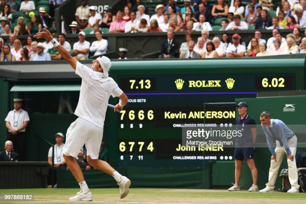 John Isner of The United States serves against Kevin Anderson of South Africa in front of the scoreboard during their Men's Singles semifinal match...