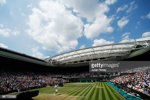John Isner of The United States serves against Kevin Anderson of South Africa during their Men's Singles semifinal match on day eleven of the...