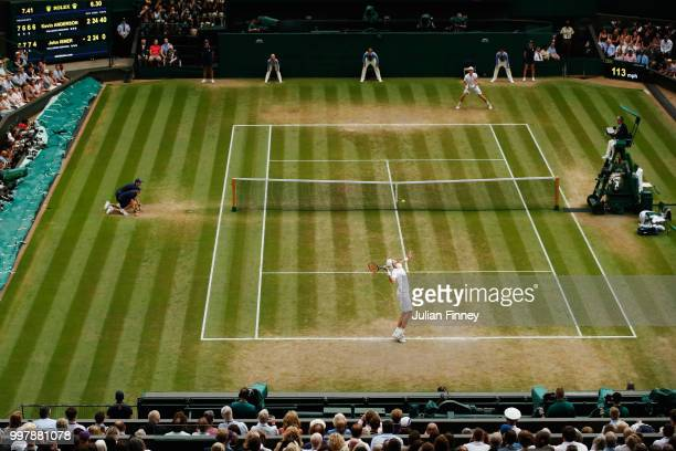John Isner of The United States serves against Kevin Anderson of South Africa during their Men's Singles semi-final match on day eleven of the...