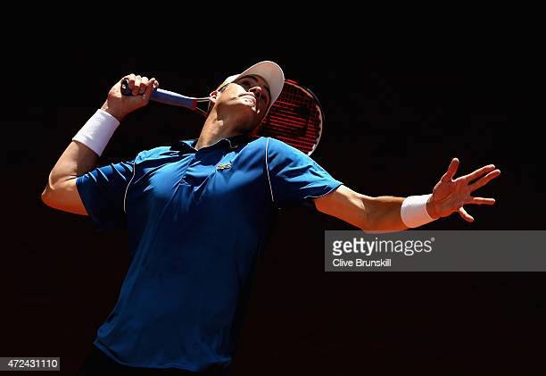 John Isner of the United States serves against Nick Kyrgios of Australia in their third round match during day six of the Mutua Madrid Open tennis...