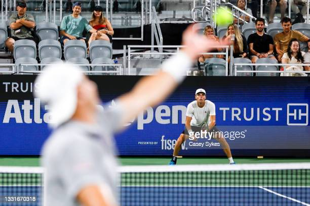 John Isner of the United States serves during a match against Christopher O'Connell of Australia at the Truist Atlanta Open at Atlantic Station on...