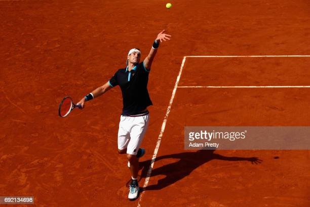 John Isner of The United States serves during the mens singles third round match against Karen Khachanov of Russia on day eight of the 2017 French...