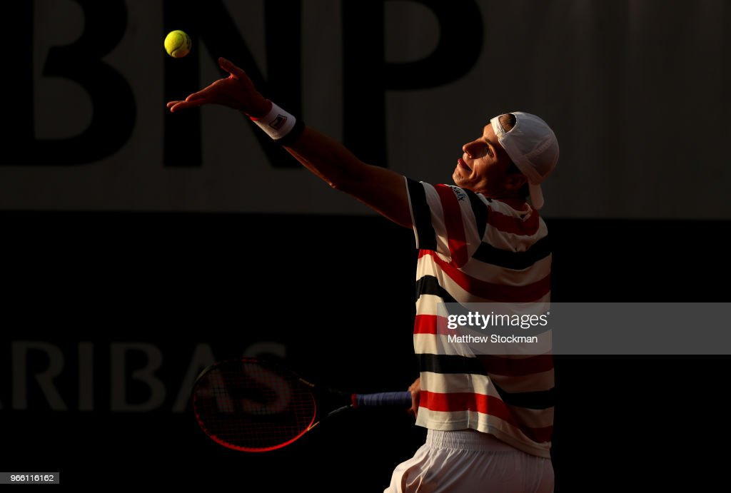 John Isner of The United States serves during the mens singles third round match against Pierre-Hugues Herbert of France during day seven of the 2018 French Open at Roland Garros on June 2, 2018 in Paris, France.