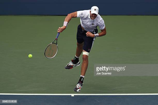 John Isner of the United States serves to Steve Darcis of Belgium during his second round Men's Singles match on Day Three of the 2016 US Open at the...