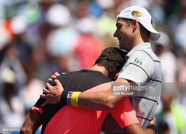 John Isner of the United States shakes hands at the net after his straight sets victory against Juan Martin Del Potro of Argentina in their semifinal...
