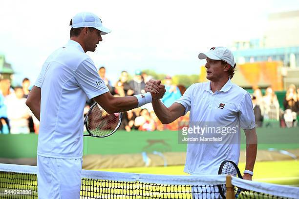 John Isner of The United States shakes hands with Matthew Barton of Australia in the Men's Singles second round match on day five of the Wimbledon...