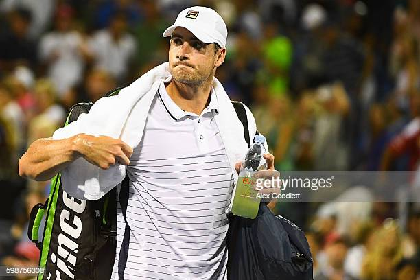 John Isner of the United States walks off the court after being defeated by Kyle Edmund of Great Britain during his third round Men's Singles match...