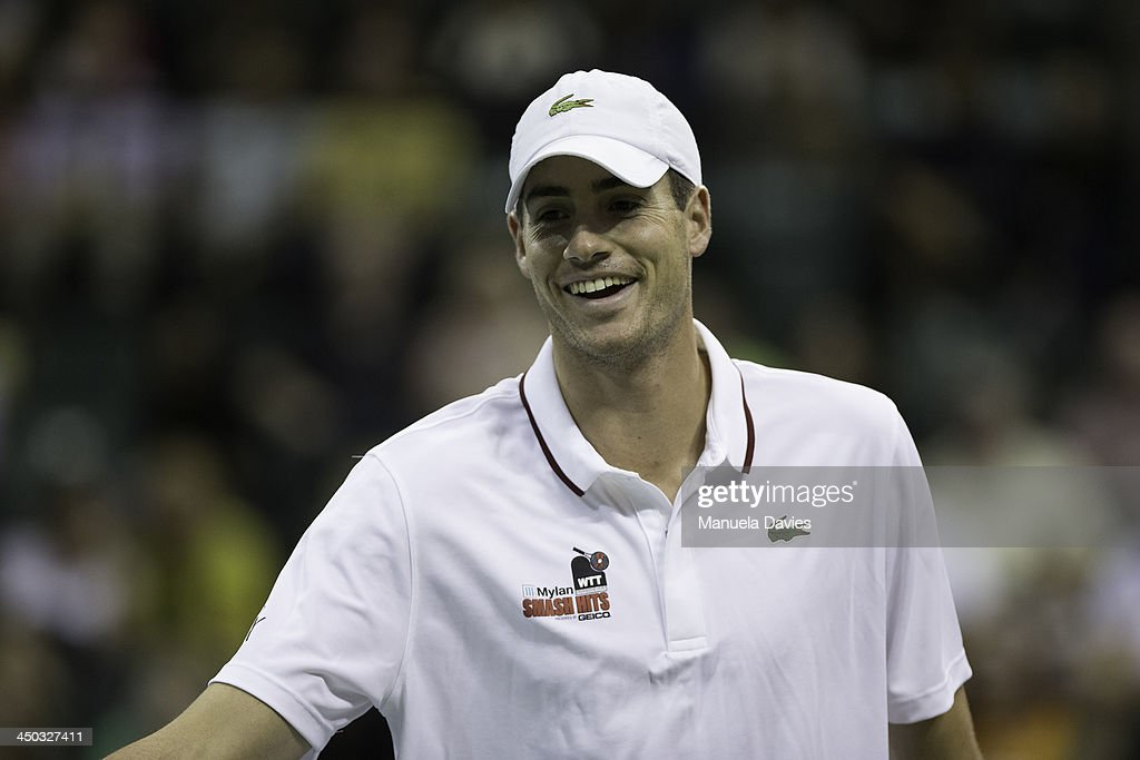 John Isner of the U.S. looks on during the exhibition doubles match against Andy Roddick and Vicky Duval during the 2013 Mylan WTT Smash Hits on November 17, 2013 at the ESPN Wide World of Sports Complex in Lake Buena Vista, Florida.