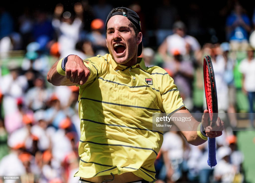 John Isner of the USA celebrates beating Alexander Zverev of Germany 6-7 6-4 6-4 in the men's final on Day 14 of the Miami Open Presented by Itau at Crandon Park Tennis Center on April 01, 2018 in Key Biscayne, Florida.
