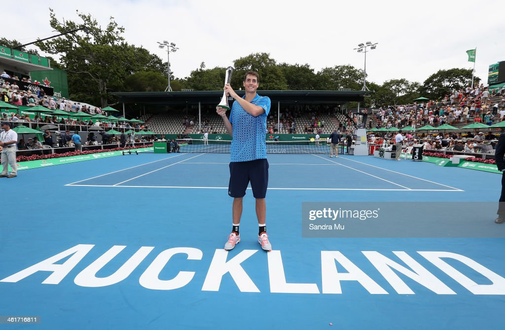 John Isner of the USA holds the trophy after his win over Yen-Hsun Lu of Chinese Tapei during the final of the Heineken Open at the ASB Tennis Centre on January 11, 2014 in Auckland, New Zealand.