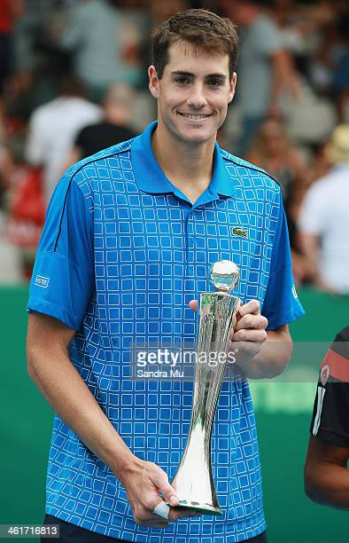 John Isner of the USA holds the trophy after his win over YenHsun Lu of Chinese Tapei during the final of the Heineken Open at the ASB Tennis Centre...