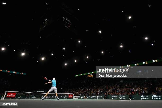 John Isner of the USA plays a forehand against Juan Martin del Potro of Argentina during Day 5 of the Rolex Paris Masters held at the AccorHotels...
