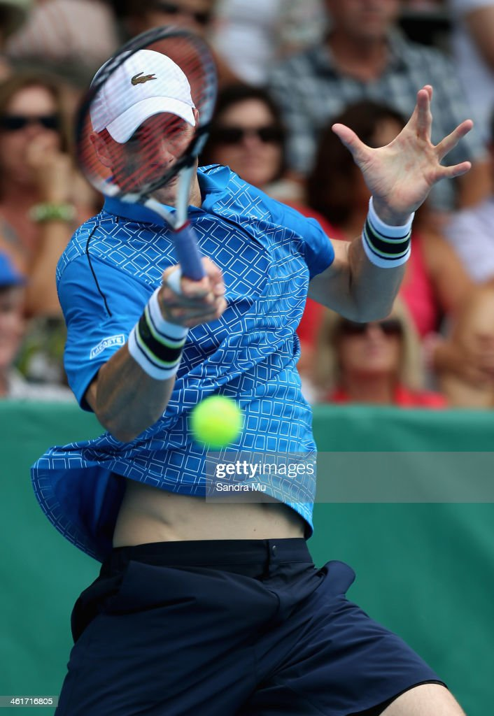John Isner of the USA plays a forehand during his finals match against Yen-Hsun Lu of Chinese Tapei on day six of the Heineken Open at the ASB Tennis Centre on January 11, 2014 in Auckland, New Zealand.