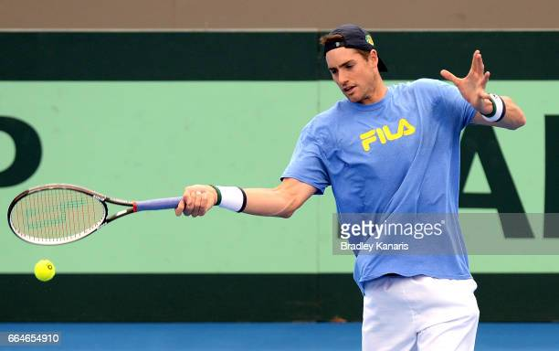 John Isner of the USA plays a forehand during practice ahead of the Davis Cup World Group Quarterfinal match between Australia and the USA at Pat...