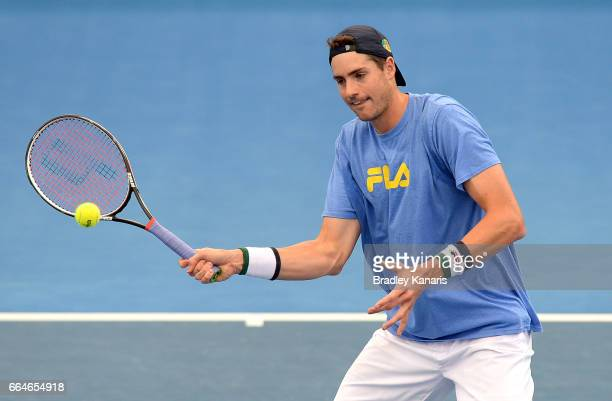 John Isner of the USA plays a shot during practice ahead of the Davis Cup World Group Quarterfinal match between Australia and the USA at Pat Rafter...