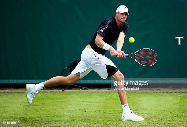 John Isner of the USA reaches for a backhand during his match against Fabio Fognini of Italy during day one of The Boodles Tennis Event at Stoke Park...
