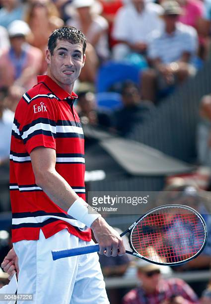 John Isner of the USA reacts in his singles game against Roberto Bautista Agut of Spain during the 2016 ASB Classic at the ASB Tennis Arena on...