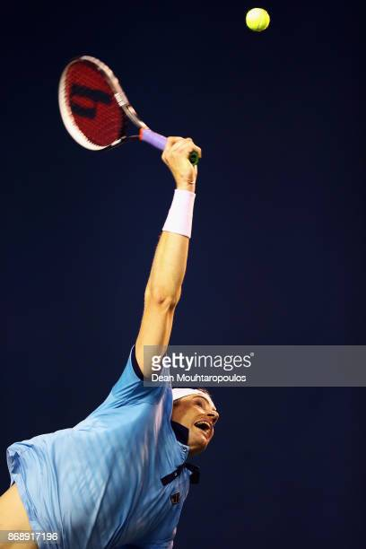 John Isner of the USA serves against Diego Schwartzman of Argentina during Day 3 of the Rolex Paris Masters held at the AccorHotels Arena on November...