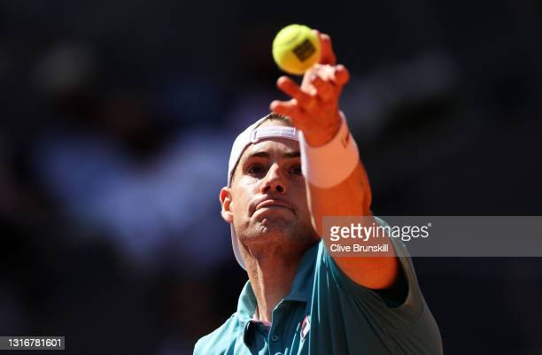 John Isner of the USA serves during their Quarter Final match against Dominic Thiem of Austria during Day Nine of the Mutua Madrid Open at La Caja...