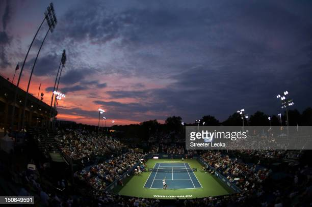 John Isner of the USA serves to David Goffin of Belgium during the quarterfinals of the Winston-Salem Open at Wake Forest University on August 23,...