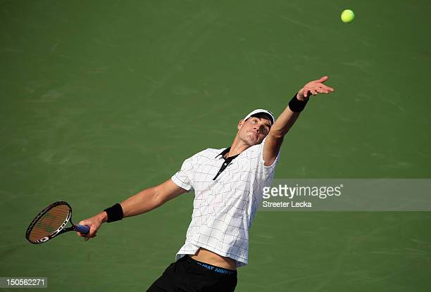 John Isner of the USA serves to Martin Klizan of Slovakia during their match in the second round of the WinstonSalem Open at Wake Forest University...