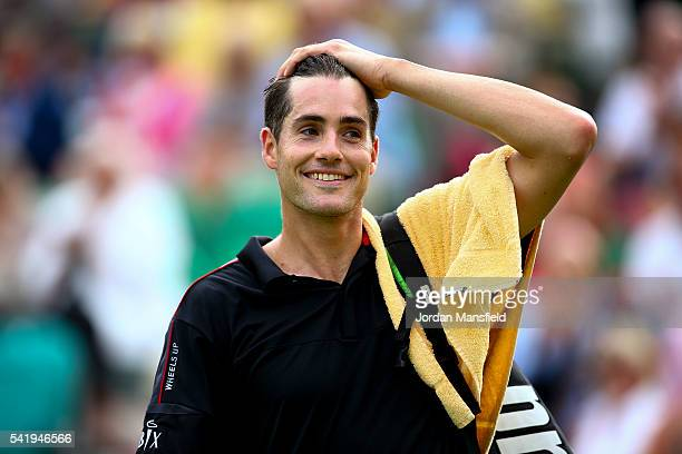 John Isner of the USA walks off court after his match against Fabio Fognini of Italy during day one of The Boodles Tennis Event at Stoke Park on June...