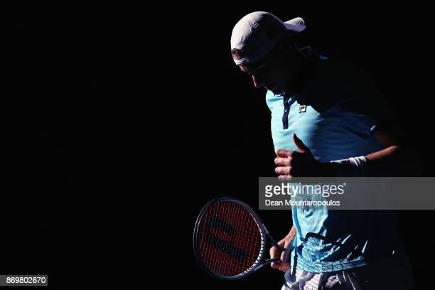 John Isner of the USA warms up prior to his match against Juan Martin del Potro of Argentina during Day 5 of the Rolex Paris Masters held at the...